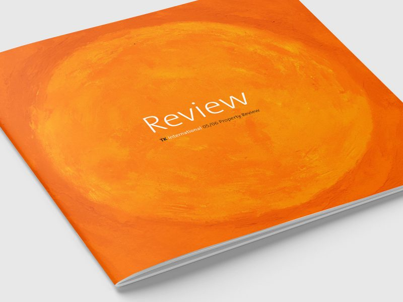 TK International Review Brochure Design